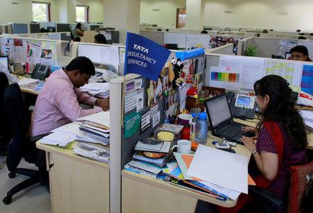 FILE PHOTO: Employees of Tata Consultancy Services (TCS) work inside the company headquarters in Mumbai