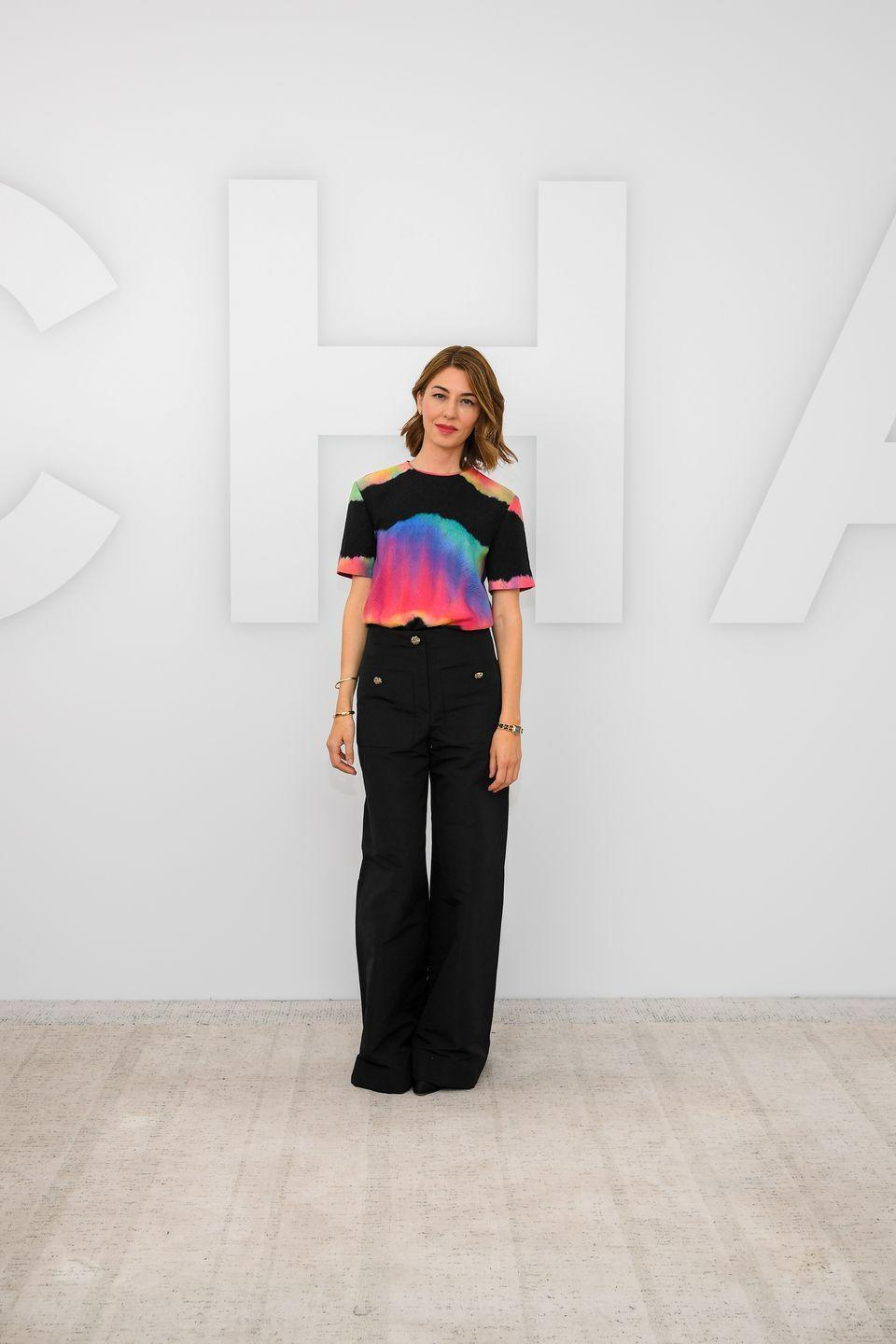 <p><strong>6 October </strong>Sofia Coppola teamed her wide-leg trousers with a colourful Chanel T-shirt.</p>