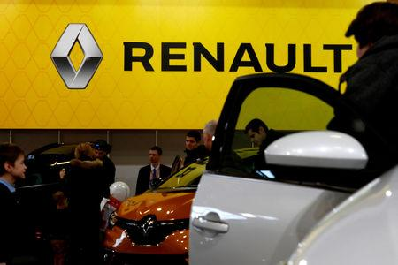 FILE PHOTO: People look on Renault cars during the international motor show Auto 2019 in Riga, Latvia April 13, 2019. REUTERS/Ints Kalnins/File Photo