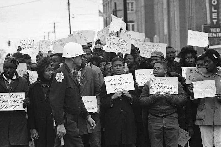Image: Sign-carrying young African Americans sing and chant as they stage a demonstration at the courthouse (Bill Hudson / AP)