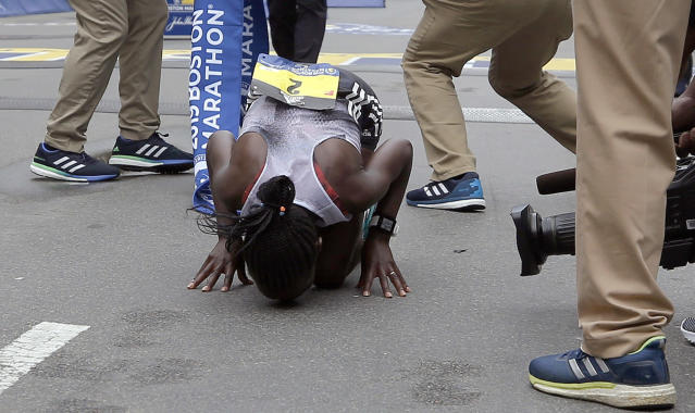 Worknesh Degefa, of Ethiopia, kisses the ground after winning the women's division of the 123rd Boston Marathon on Monday, April 15, 2019, in Boston. (AP Photo/Winslow Townson)