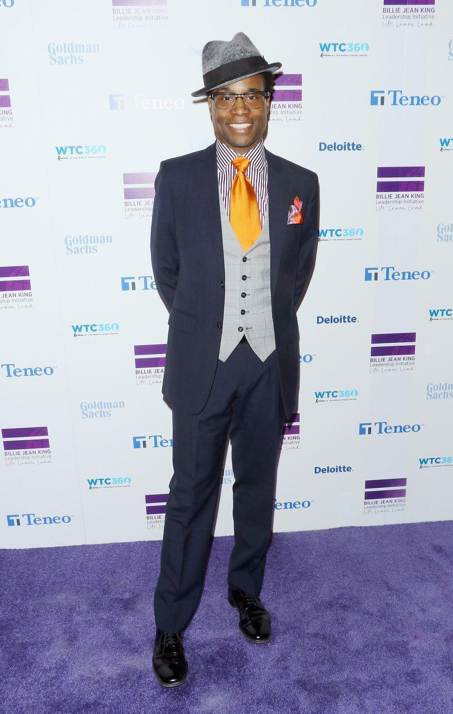 <p>Porter at the Billie Jean King Leadership Initiative gala in a three-piece suit with a gray wool hat and orange silk tie. </p>