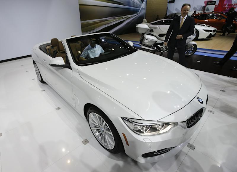 Ian Robertson, member of the Board of Management at BMW AG, introduces the 2014 BMW 428i at the Los Angeles Auto Show in Los Angeles, Wednesday, Nov. 20, 2013. (AP Photo/Chris Carlson)