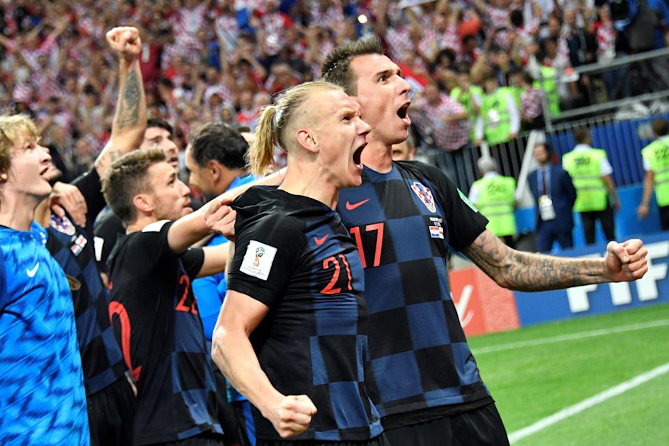 Croatia's Domagoj Vida and Mario Mandzukic celebrate their victory at the end of the Russia 2018 World Cup semi-final football match between Croatia and England. (Getty Images)