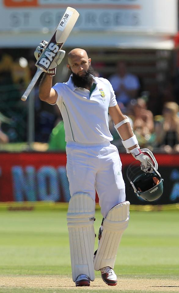 South Africa's batsman Hashim Amla, raises his bat after reaching his century on the fourth day of their second cricket test match against Australia at St George's Park in Port Elizabeth, South Africa, Sunday, Feb. 23, 2014. (AP Photo/ Themba Hadebe)