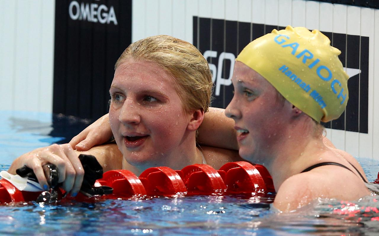 LONDON, ENGLAND - MARCH 08:  Hannah Miley of Garioch ASC (R) congratulates heat winner Rebecca Adlington of Nova Centurion SC after competing in the Women's Freestyle 800m Heat 4 during day six of the British Gas Swimming Championships at The London Aquatics Centre on March 8, 2012 in London, England.  (Photo by Clive Rose/Getty Images)