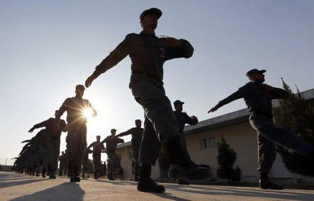 Afghan National Police officers march at a training centre near the German Bundeswehr army camp in Kunduz