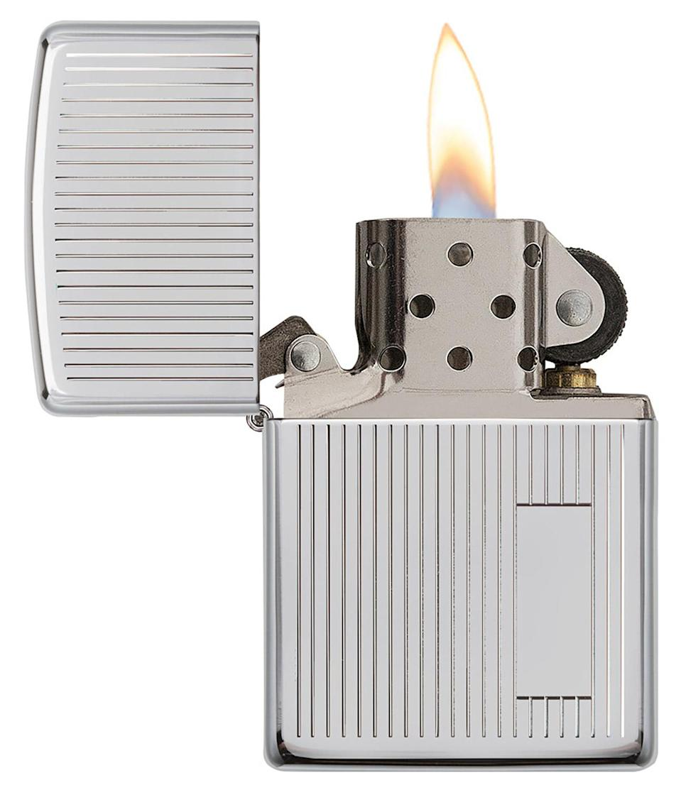 """<p>A particularly outdoorsy dad in your life (you know, the one who's always trying to start a campfire or light a grill) will appreciate this classic, refillable and windproof lighter that has a classy touch: You can engrave his initials on it, so everyone will know who's in charge of the cookout. </p> <p><strong>Buy It! </strong>Zippo """"Stripes"""" lighter, $31.45; <a href=""""https://www.zippo.com/products/stripes"""" rel=""""sponsored noopener"""" target=""""_blank"""" data-ylk=""""slk:zippo.com"""" class=""""link rapid-noclick-resp"""">zippo.com</a></p>"""