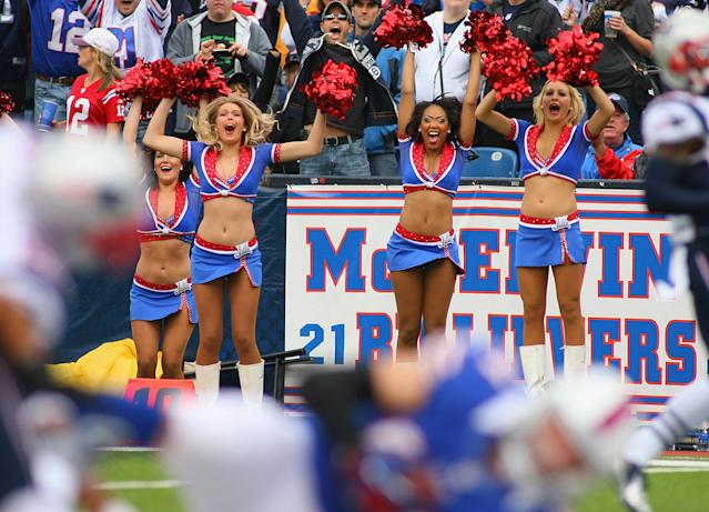 ORCHARD PARK, NY - SEPTEMBER 30: Members of the Buffalo Jills celebrate as Scott Chandler #84 of the Buffalo Bills falls into the endzone for a touchdown against the New England Patriots at Ralph Wilson Stadium on September 30, 2012 in Orchard Park, New York.New England won 52-28. (Photo by Rick Stewart/Getty Images)