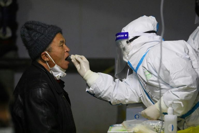 A resident is tested in the Hebei city of Shijiazhuang, epicentre of the latest outbreak