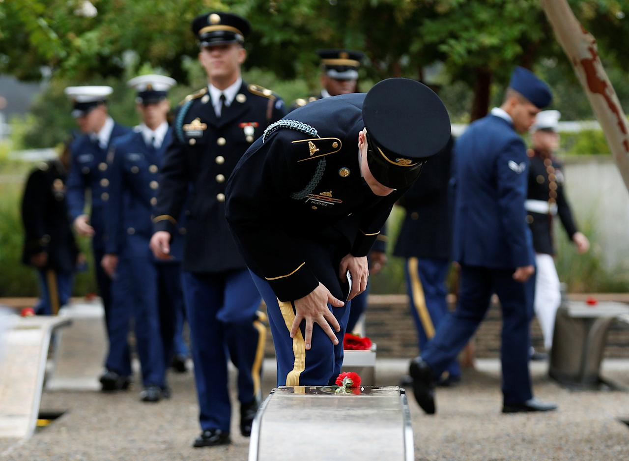 <p>A member of the U.S. Army checks the name on a memorial bench during the 17th annual September 11 observance ceremony at the Pentagon in Washington, Sept. 11, 2018. (Photo: Joshua Roberts/Reuters) </p>