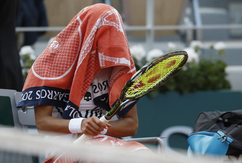 Vitalia Diatchenko of Russia covers herself with a towel after her loss against Serena Williams of the U.S. during their first round match of the French Open tennis tournament at the Roland Garros stadium in Paris, Monday, May 27, 2019. (AP Photo/Pavel Golovkin)