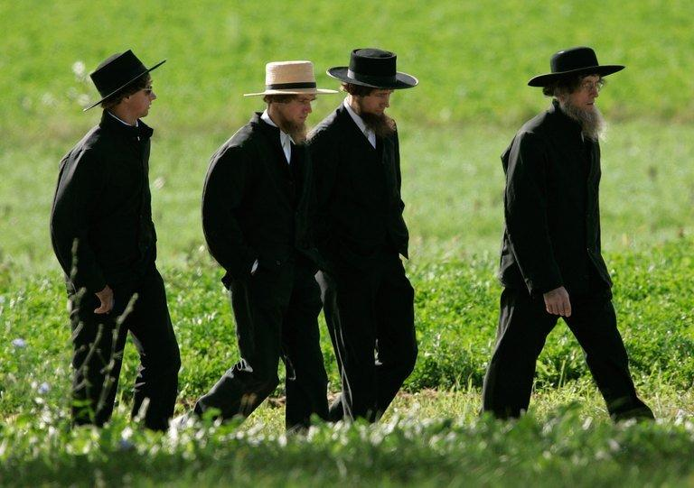 Amish men walk to a funeral for a victim of the Amish schoolhouse shootings, on October 5, 2006, in Pennsylvania