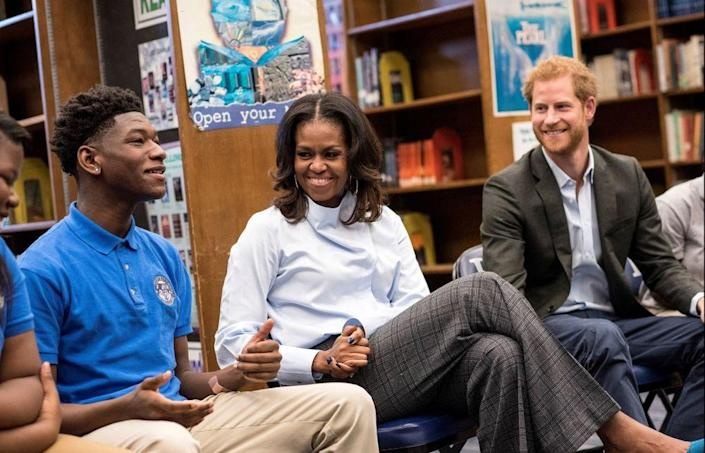 Michelle Obama and Prince Harry speak to students at Hyde Park Academy in Chicago, Ill.