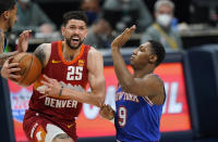 Denver Nuggets guard Austin Rivers, left, drives to the rim as New York Knicks guard RJ Barrett defends in the first half of an NBA basketball game Wednesday, May 5, 2021, in Denver. (AP Photo/David Zalubowski)