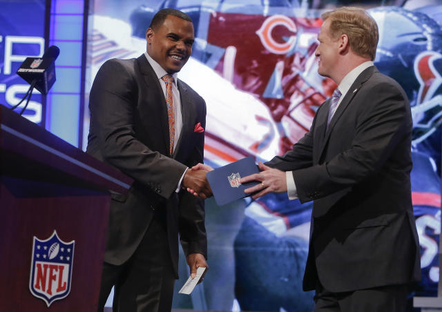 Former Houston Texans outside guard Chester Pitts, left, greets NFL commissioner Roger Goodell before announcing UCLA outside guard Xavier Su'a-Filo as theTexans' second pick in the second round of the 2014 NFL Draft, Friday, May 9, 2014, in New York. (AP Photo/Jason DeCrow)