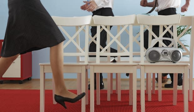 executives playing musical chairs