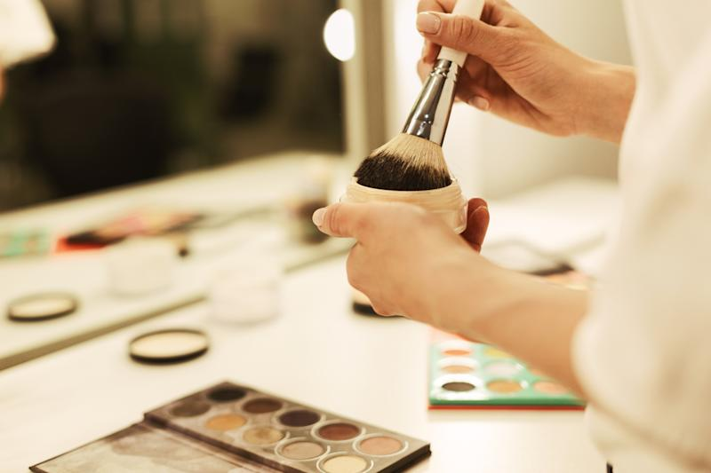 Self Makeup. Closeup Of Woman's Hands Holding Blush Or Powder Brush Next To Mirror. Copy Space, Selective Focus