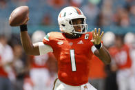 Miami quarterback D'Eriq King (1) throws a pass during the second quarter of an NCAA college football game against Michigan State, Saturday, Sept. 18, 2021, in Miami Gardens, Fla. (AP Photo/Michael Reaves)