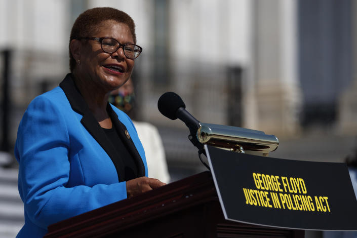 """Rep. Karen Bass speaks during a news conference on the House East Front Steps on Capitol Hill in Washington at a podium with a sign reading """"George Floyd Justice in Policing Act"""""""