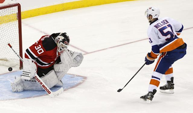 New York Islanders center Frans Nielsen (51), of Denmark, scores a goal against New Jersey Devils goalie Martin Brodeur (30) during a shootout in an NHL hockey game, Friday, April 11, 2014, in Newark, N.J. The Islanders won 3-2. (AP Photo/Julio Cortez)