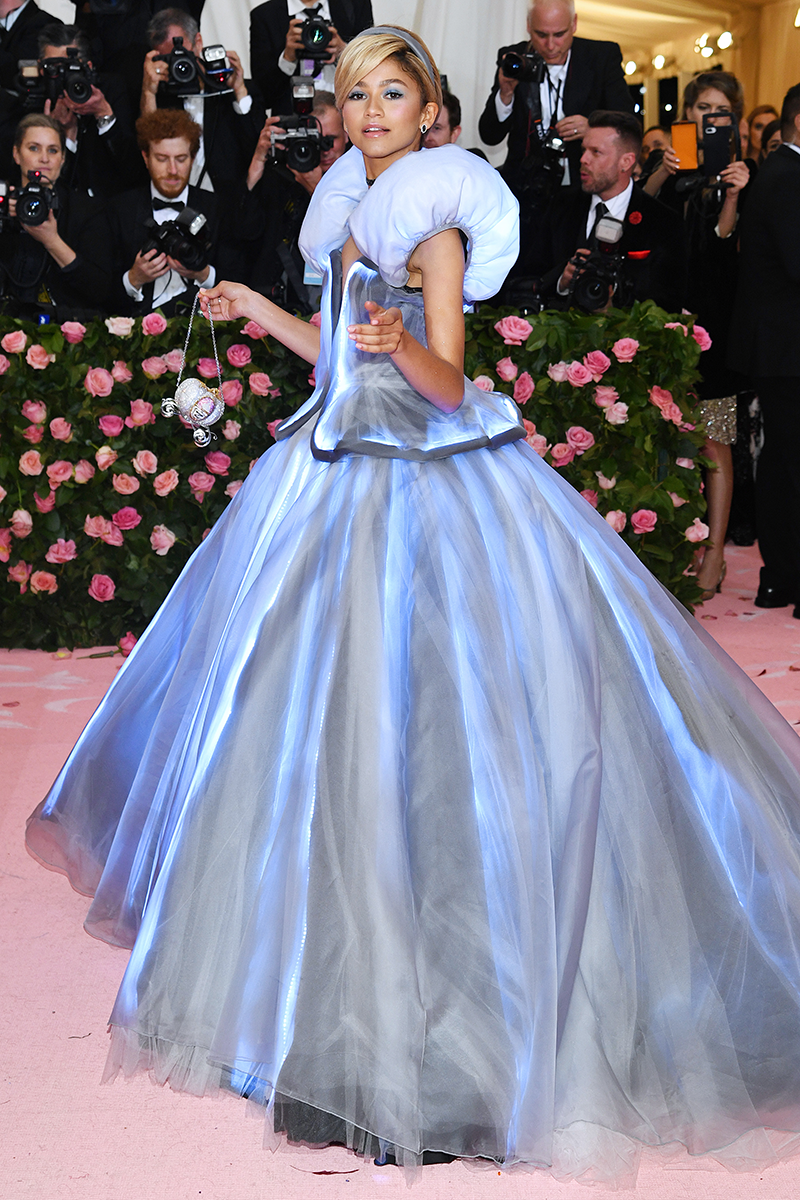 """<p>Throwback to the time that Zendaya was an actual princess (<a href=""""https://www.cosmopolitan.com/uk/fashion/celebrity/a27387250/zendaya-cinderella-met-gala/"""" rel=""""nofollow noopener"""" target=""""_blank"""" data-ylk=""""slk:Cinderella"""" class=""""link rapid-noclick-resp"""">Cinderella</a>, to be specific) at the <a href=""""https://www.cosmopolitan.com/uk/fashion/celebrity/a27389031/met-gala-2019-best-fashion-memes/"""" rel=""""nofollow noopener"""" target=""""_blank"""" data-ylk=""""slk:2019 Met Gala"""" class=""""link rapid-noclick-resp"""">2019 Met Gala</a> wearing a light-up dress by Tommy Hilfiger. We're still not over that matching pumpkin carriage handbag AND those glass slippers, of course </p>"""
