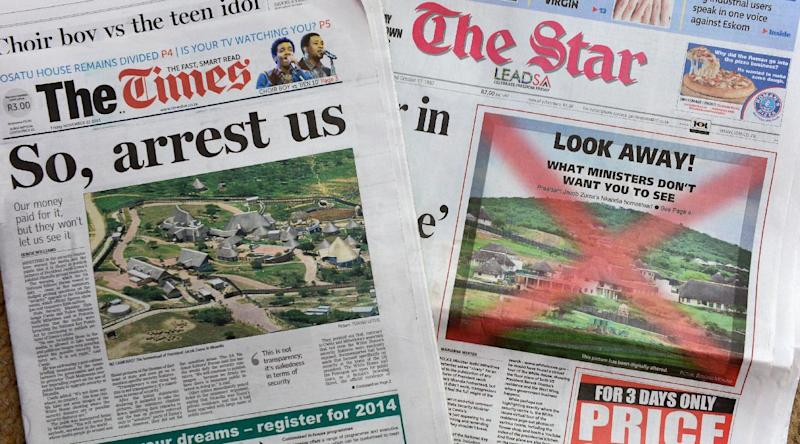 This picture taken on November 22, 2013 in Johannesburg shows the covers of two South African newspapers which defied government threats and published pictures of President Jacob Zuma's home, controversially revamped using $20 mn of taxpayer money