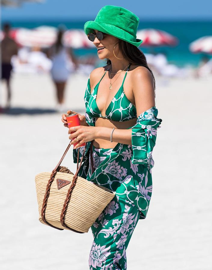 <p>Shay Mitchell hits the beach in a stylish green outfit on Saturday in Miami.</p>