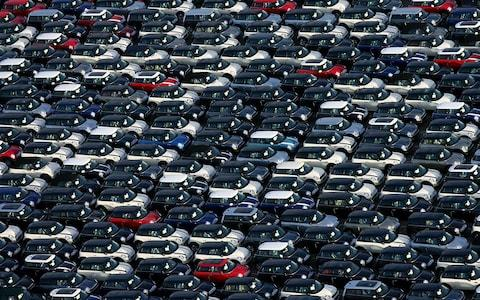 British built cars await export at Southampton docks - Credit: PA