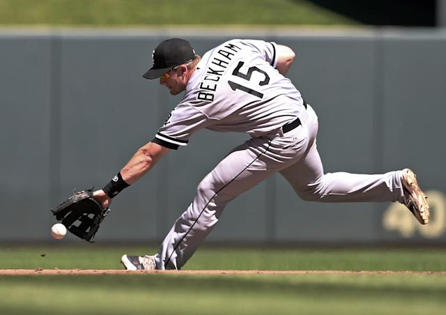 Chicago White Sox second baseman Gordon Beckham runs down a sharp grounder from Minnesota Twins' Brian Dozier, who singled, in the seventh inning of a baseball game, Saturday, June 21, 2014, in Minneapolis. The Twins won 4-3. (AP Photo/Jim Mone)