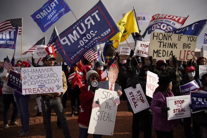 Supporters of President Donald Trump protest the election outside of the Clark County Election Department in North Las Vegas.