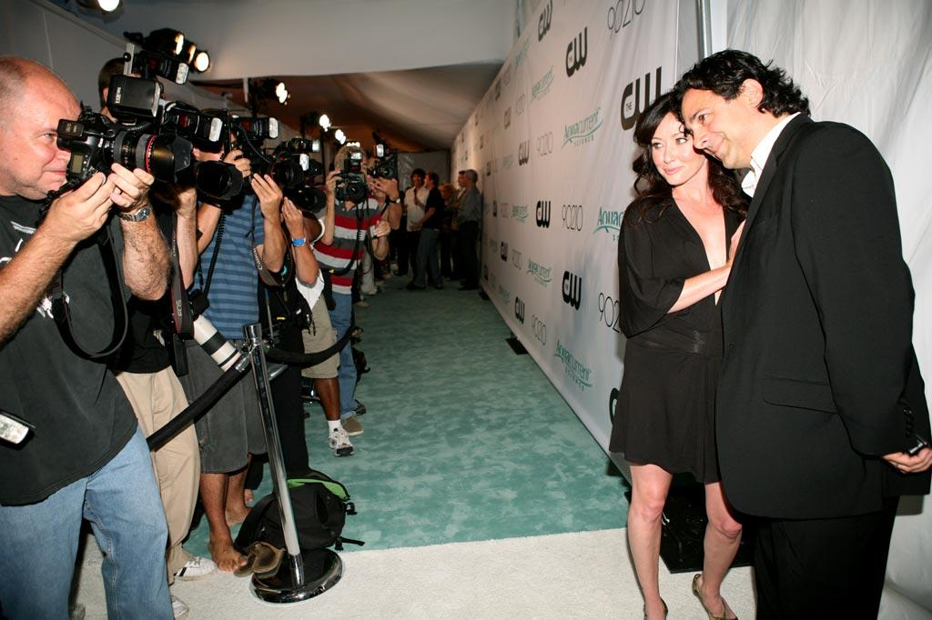 """Shannen Doherty poses with producer Gabe Sachs at the <a href=""""/90210/show/43006"""">""""90210""""</a> Launch Party on Saturday, 8/23 in Malibu, California."""