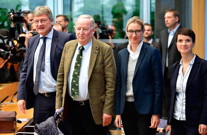 <strong>AfD officials at a press conference on Monday, after it won seats in the Bundestag.</strong><br /><strong>(L-R) Co-leader Joerg Meuthen, top candidate Alexander Gauland, top candidate Alice Weidel and co-leader Frauke Petry.</strong><br /><strong>Petry later said she wouldn't join the AfD's party's parliamentary group and walked out of the press conference, amid a bitter dispute with more hardline colleagues.</strong> (TOBIAS SCHWARZ via Getty Images)