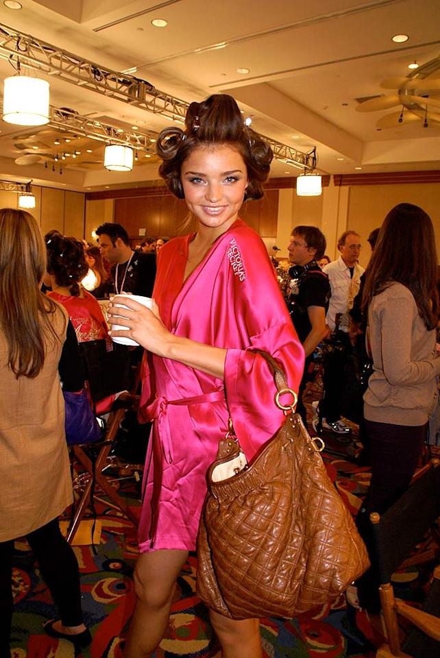 "Most women wouldn't be caught dead in their curlers and dressing gown, but Australian Angel Miranda Kerr doesn't seem to mind one bit. omg! staff/<a href=""http://omg.yahoo.com"" target=""new"">omg!</a> - November 15, 2007"