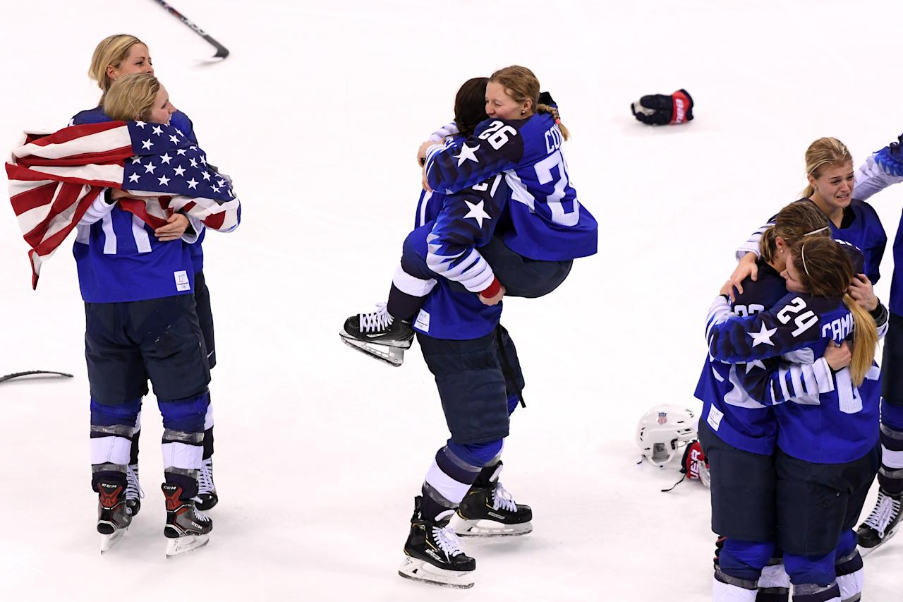 <p>Hilary Knight #21 hugs Kendall Coyne #26 of the United States after defeating Canada in overtime to win the Women's Gold Medal Game on day thirteen of the PyeongChang 2018 Winter Olympic Games at Gangneung Hockey Centre on February 22, 2018 in Gangneung, South Korea. (Photo by Harry How/Getty Images) </p>
