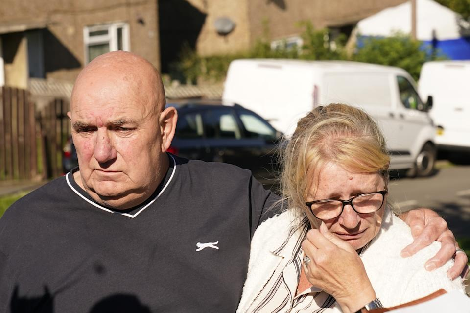 Debbie and Trevor Bennett, the grandparents of two of the victims, speaking to the media at the scene in Chandos Crescent in Killamarsh, near Sheffield, where four people were found dead at a house on Sunday. Derbyshire Police said a man is in police custody and they are not looking for anyone else in connection with the deaths. Picture date: Monday September 20, 2021.