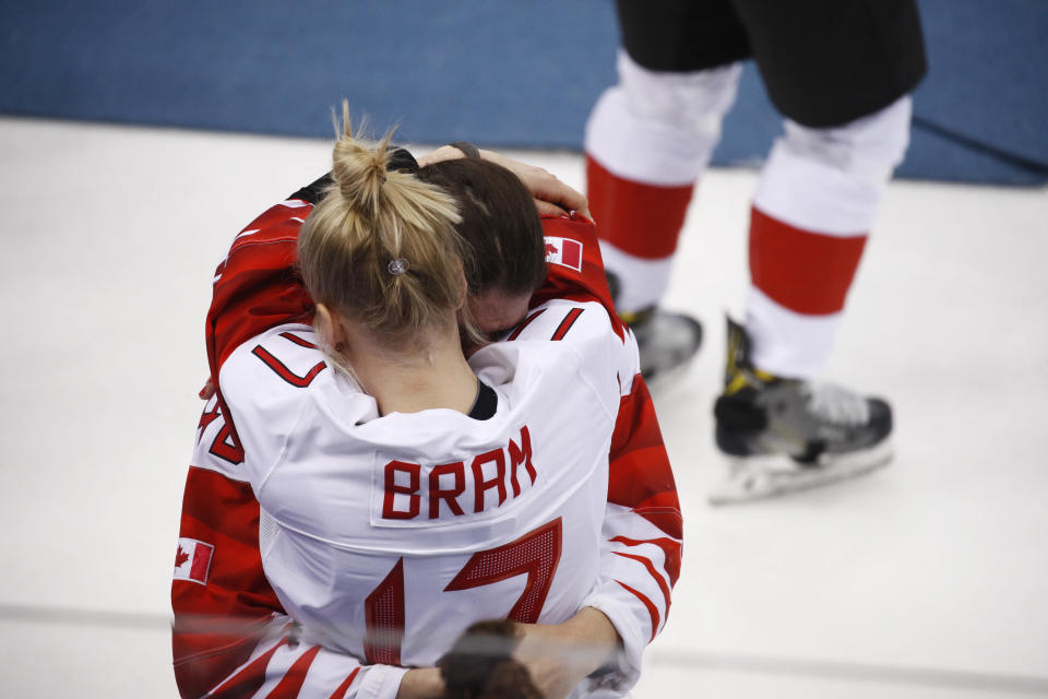 <p>Bailey Bram (17), of Canada, embraces a teammate after losing to the United States in the women's gold medal hockey game at the 2018 Winter Olympics in Gangneung, South Korea, Thursday, Feb. 22, 2018. (AP Photo/Jae C. Hong) </p>