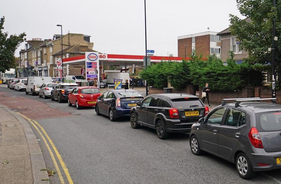 Motorists queue at an Esso petrol station in Brockley, south London (Dominic Lipinski/PA) (PA Wire)