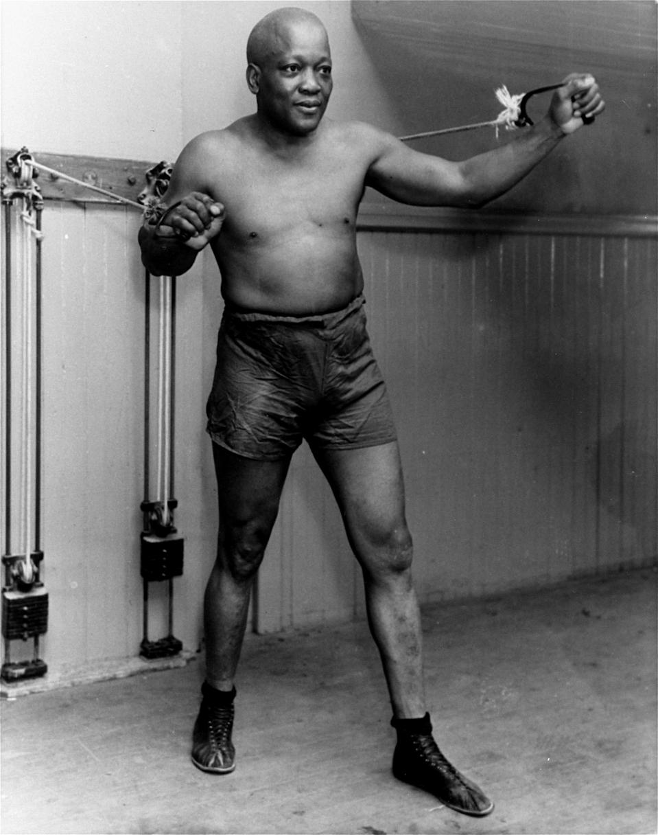 FILE – In this 1932 photo, boxer Jack Johnson poses for a photo in New York City at the age of 54. (AP Photo/File)