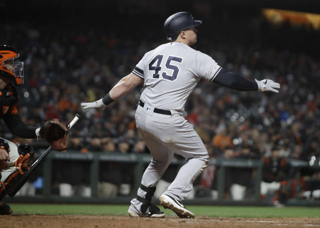 New York Yankees' Luke Voit watches his two run home run hit off San Francisco Giants' Mark Melancon in the ninth inning of a baseball game Friday, April 26, 2019, in San Francisco. (AP Photo/Ben Margot)