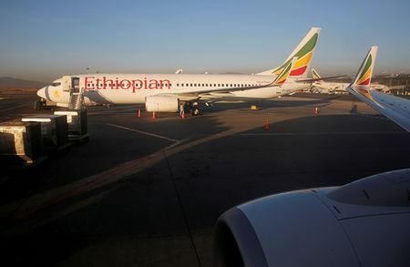 Workers service an Ethiopian Airlines Boeing 737-800 plane at the Bole International Airport in Ethiopia's capital Addis Ababa, January 26, 2017. REUTERS/Amr Abdallah Dalsh/File Photo