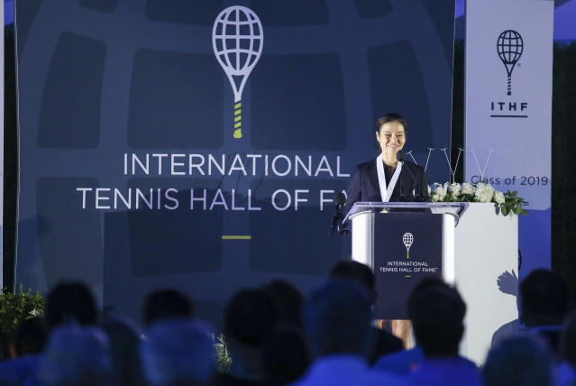 Tennis Hall of Fame inductee Li Na, of China, speaks to the crowd during ceremonies at the International Tennis Hall of Fame, Saturday, July 20, 2019, in Newport, R.I. (AP Photo/Stew Milne)
