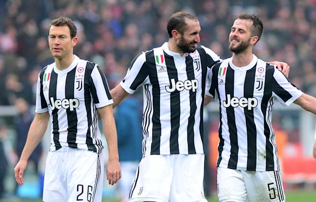 Soccer Football - Serie A - Torino vs Juventus - Stadio Olimpico Grande Torino, Turin, Italy - February 18, 2018 Juventus' Giorgio Chiellini, Miralem Pjanic and Stephan Lichtsteiner celebrate in front of their fans at the end of the match REUTERS/Massimo Pinca