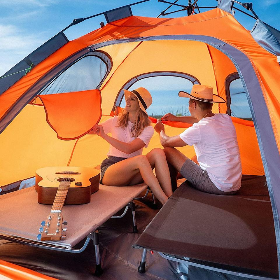 """<p>This popular <a href=""""https://www.popsugar.com/buy/Moon-Lence-Instant-Pop-Up-Tent-Family-Camping-Tent-584338?p_name=Moon%20Lence%20Instant%20Pop%20Up%20Tent%20Family%20Camping%20Tent&retailer=amazon.com&pid=584338&price=104&evar1=savvy%3Aus&evar9=47570402&evar98=https%3A%2F%2Fwww.popsugar.com%2Fsmart-living%2Fphoto-gallery%2F47570402%2Fimage%2F47570440%2FMoon-Lence-Instant-Pop-Up-Tent-Family-Camping-Tent&list1=travel%2Camazon%2Ccamping&prop13=mobile&pdata=1"""" rel=""""nofollow"""" data-shoppable-link=""""1"""" target=""""_blank"""" class=""""ga-track"""" data-ga-category=""""Related"""" data-ga-label=""""https://www.amazon.com/Portable-Automatic-Waterproof-Windproof-Mountaineering/dp/B0827J91VF/ref=sr_1_1?dchild=1&amp;keywords=camping+tents&amp;qid=1593017832&amp;sr=8-1"""" data-ga-action=""""In-Line Links"""">Moon Lence Instant Pop Up Tent Family Camping Tent</a> ($104) currently boasts a five-star rating.</p>"""