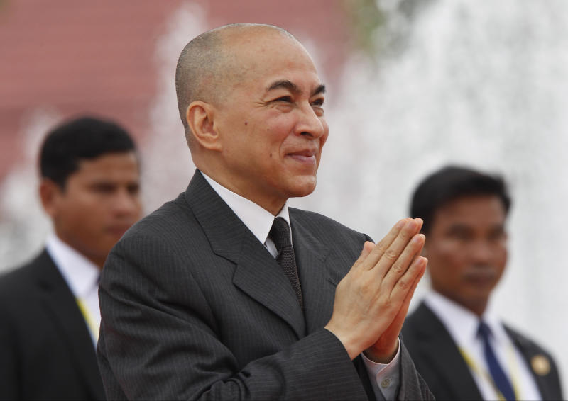 Cambodia's King Norodom Sihamoni, center, greets his government officers during the Independence Day celebrations in Phnom Penh, Cambodia, Thursday, Nov. 9, 2017. Sihamoni is joined by civil servants and students to mark the country's 64th Independence Day. The country gained independence from France on Nov. 9, 1953. (AP Photo/Heng Sinith)