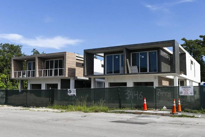 New boxy duplexes in one of Miami's oldest neighborhoods have replaced the tree-shaded homes that used to stand on the 3400 block of Day Avenue in West Coconut Grove.