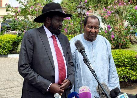 South Sudan's President Salva Kiir, flanked by Mali's former President Alpha Oumar Konare, African Union High Representative for South Sudan, addresses a news conference at the Presidential State House following the recent fighting in South Sudan's capital Juba, July 14, 2016. REUTERS/Stringer