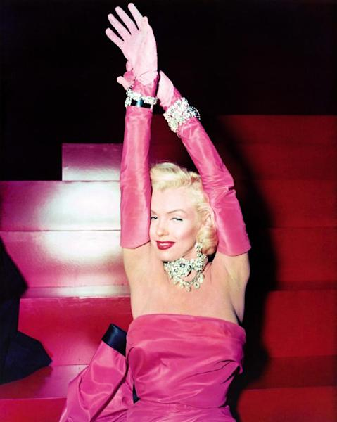 """FILE - In this 1953 publicity file photo provided by Running Press, Marilyn Monroe is shown on set in the film, """"Gentlemen Prefer Blondes."""" Monroe is probably best remembered for her comic turns in this film. The picture is included in a new 2012 book, """"Marilyn in Fashion,"""" published by Running Press. (AP Photo/Courtesy Running Press)"""