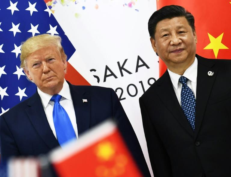 US President Donald Trump and China's Xi Jinping -- seen here in June 2019 -- started to redefine one of the world's most significant geopolitical relationships in the 2010s (AFP Photo/Brendan Smialowski)