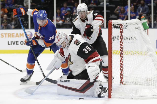 Arizona Coyotes goaltender Darcy Kuemper (35) stops a shot on the goal as New York Islanders' Brock Nelson (29) watches during the second period of an NHL hockey game Thursday, Oct. 24, 2019, in Uniondale, N.Y. (AP Photo/Frank Franklin II)